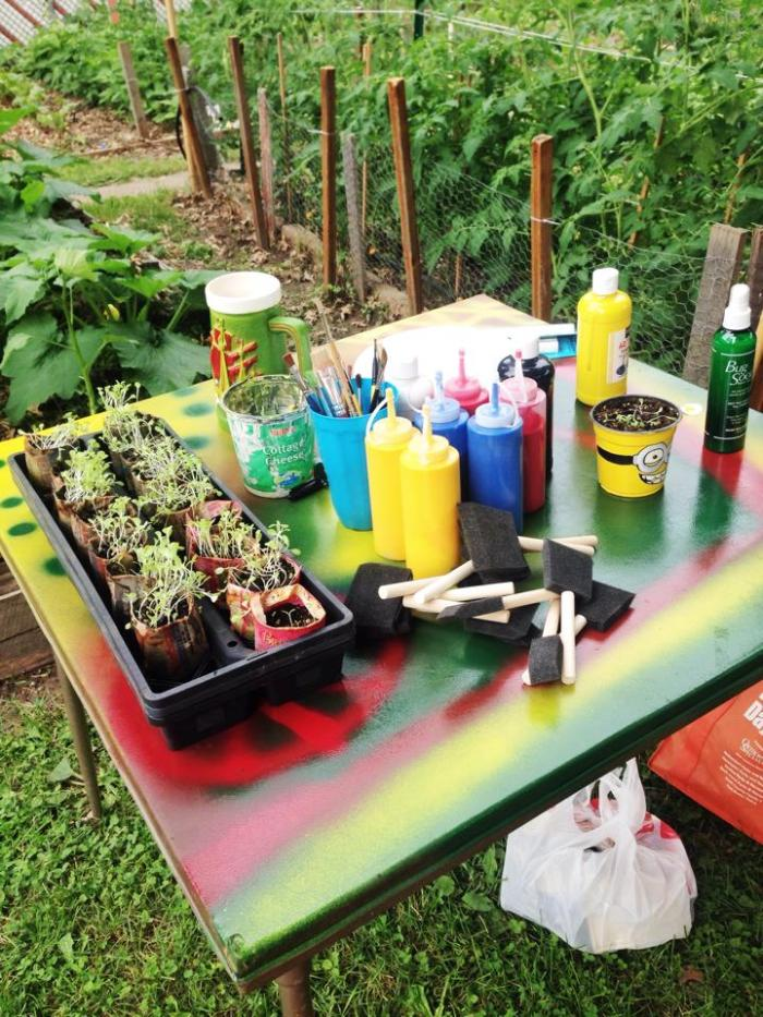 Children's plant-painting station.