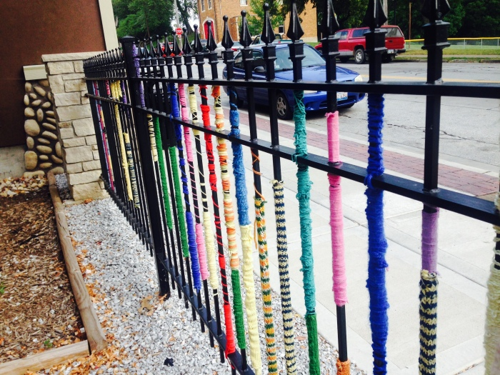 A yarn-bombed fenceline :)